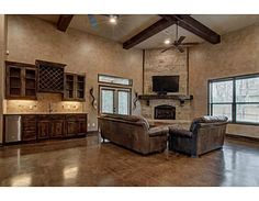 4102 Rocky Briar Ct, College Station, TX PERFECT FOR ENTERTAINING! This 3 bed, 2 bath home boasts an IMPRESSIVE great room with soaring ceilings accented with refined 12 inch cedar beams, a floor-to-ceiling stone fireplace, and a expansive wet-bar! The chef's kitchen boasts custom cabinetry, stainless appliances, & all of this leads out to an amazing covered outdoor living space with a huge outdoor kitchen/bar, mosquito misting system and stained firepit patio! Agent: Luke Marvel