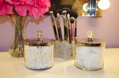 Love this idea for cotton balls, cotton pads, and q-tip storage! Old candle holders with knobs!