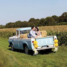A cozy finale for a country-chic wedding: a photo op on the back of a vintage pickup truck. Quilt, $75, Abigails; Ribbon, $9.55 for 20 yards, The Ribbon Retreat Wholesale; Fourteen-inch tissue pom-poms, $9.98 for two, Dress My Cupcake; Tulle dress, $2,600, Tracy Reese for BHLDN; Tuxedo shirt, $325, and pinstripe pants, $695, Anthony Franco; Suspenders, $88, Bonobos