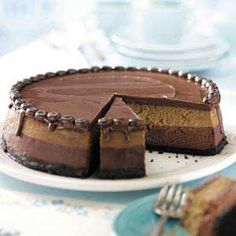 Chocolate cheesecake on the bottom and coffee cheesecake on the top with a choco glaze.