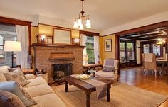 yellow walls, Cozy craftsman living room - good colors. Wood detailing for hubby...