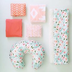 It's the new #iviebaby winter floral cloud blanket! Pictured here with our winter floral boppy cover, solid coral crib sheet, coral chevron changing pad cover, pink kilim crib sheet, and coral watercolor dots changing pad cover. ❤️