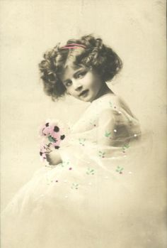 Pretty little girl photograph in sepia tones with colored flower.