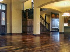 Gorgeous dark wood flooring, warm textured walls, and dark wood trim. Perfect for my dream house!! :]