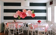 This is the most amazing accent wall we have ever seen! Huge paper flowers adorn bold stripes.