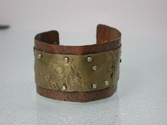 Copper and Reticulated Brass Cuff, Sterling Rivets, Industrial Rustic Metalsmith Artist Jewelry, Statement Bracelet, Cold Connected by SilverSeahorseDesign on Etsy https://www.etsy.com/listing/153070079/copper-and-reticulated-brass-cuff