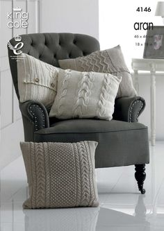 Knitted aran cushion covers scattered on an elegant upholstered armchair - King Cole
