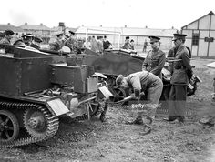 World War II, 18th July 1940, King George VI watches a new recruit to the Royal fusiliers at Hounslow Barracks, Middlesex working on a Bren gun carrier