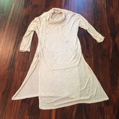 Super Comfy Ivory Tunic Tunic with slits up each side and pocket in center. Cal-neck with drawstring, worn a couple of times and still has a lot of wear in it. Slight snag on sleeve (pictured). Shoulder to hem measures 35 inches, slits are 18 inches. Tag says sz small but runs big! Hip Tops Tunics