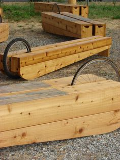 Movable seating for the Gathering Place at Hunter's was created with recycled materials, including bicycle wheels so that the benches can be lifted like a wheelbarrow.