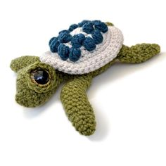 This is Ernest, the cutest little turtle in the Sea! Ernest measures about 6 inches in a DK yarn, but he can be made from any weight yarn and appropriate hook for different sizes. It is an easy pattern to follow with plenty of diagrams and you will always be welcome to contact me for any extra help. The instructions for this pattern are written in UK terms but if you are used to American terms, don't worry, the differences are all explained in the pattern. Materials needed: • 50g ball DK…