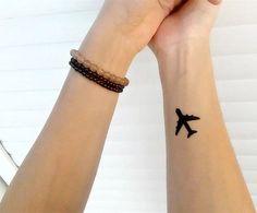 small plain tattoo on wrist