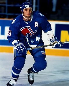 Mike Ricci | Quebec Nordiques Nhl Hockey Teams, Stars Hockey, Bruins Hockey, Ice Hockey, Sheffield Steelers, Quebec Nordiques, Goalie Mask, Different Sports, Sports Uniforms