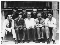 Surrealists: Man Ray, Jean Arp, Yves Tanguy, André Breton; Tristan Tzara, Salvador Dalí, Paul Eluard, Max Ernst and Rene Clevel, 1930.