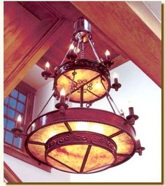 """This beatifully designed light will need a lot of room and a high ceiling. Three tiers of scroll, braid, hand twisted iron and candles along with bulbs give off plenty of light. Gold or silver mica available. All finishes are available. This light is UL listed to hold eight 60 watt bulbs and up to sixteen 25 watt candle light bulbs. 48"""" Diameter 84"""" Tall."""