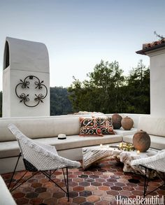 spanish colonial home with a global twist   outdoor patio via coco+kelley