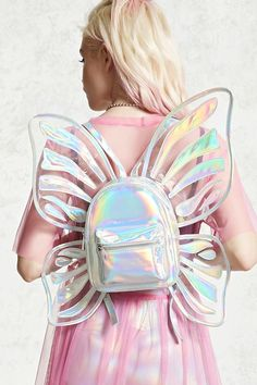 A structured faux patent leather backpack featuring a holographic finish with a butterfly wings design, two zipper compartments, an interior zipper pocket, two interior slip pockets, and adjustable buckled shoulder straps.