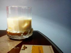 Tequila milk drink with almond sauce and caramel syrup