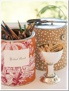 Decorate paint or soup cans with wallpaper or scrapbook paper for an simple and sweet way to add a touch of beauty to your room.