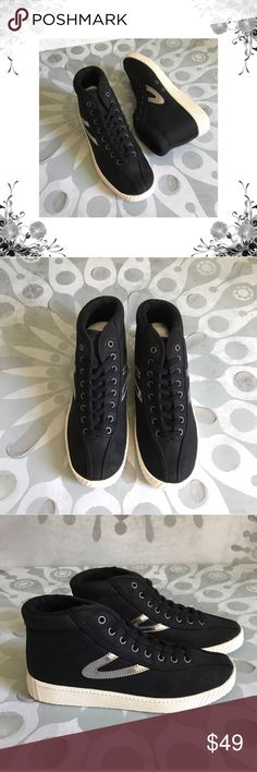 """Tretorn 'Nylitehi' Mid-Top Sneakers Manufacturer Color is Black/Black/Silver. New with box. Heel Height is approx 1"""". Platform Height is approx 3/4"""". Laces closure. Material is Textile/Man Made. Fabric Type is Canvas. Faux Leather Trim. Bundle for discounts! Thank you for shopping my closet! Tretorn Shoes Sneakers"""