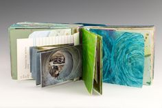 handbound sketchbook pages with a tunnel book tucked inside by Ellen Golla.