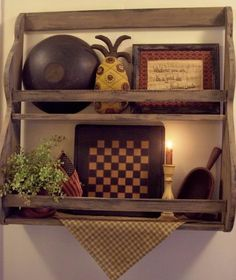 Primitive Shelf Decor - Mix a gameboard with a antique bowl, sampler and more to add an interest to a shelf. The mix of color and texture is great. Best Primitive Decorating Ideas, http://hative.com/best-primitive-decorating-ideas/,