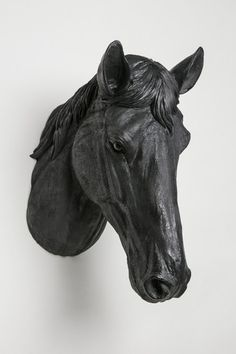 Interior Illusions Horse Head Taxidermy. The Horse Head Taxidermy is a playful take on the traditional animal head which is traditionally mounted over the fireplace mantle or in recreation rooms. This horse head is Black and crafted from resin, which gives the piece a pure Black finish that dazzles on your wall.