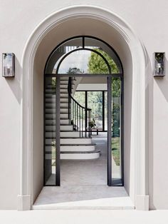 A glass and iron front door that mixes traditional with contemporary design elements. Designed by Robson Rak Architects. The firm has been shortlisted for 2016 Australian Interior Design Awards.