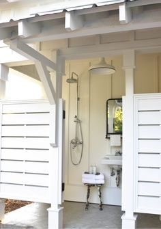 Outdoor Pool Shower with White Barn Light A porcelain pendant light brightens this dreamy outdoor shower! Outdoor Pool Shower, Outdoor Baths, Outdoor Bathrooms, Outdoor Shower Enclosure, Outdoor Kitchens, Outdoor Rooms, Outdoor Fun, Beach Cottage Style, Coastal Cottage