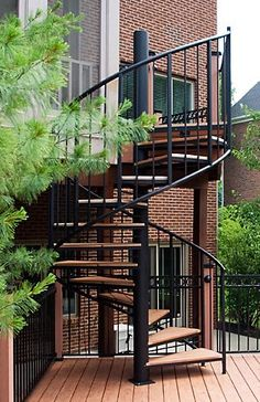 Goddard Spiral Stairs creates steel staircase railing, Wood staircase railing - Custom staircase railing.