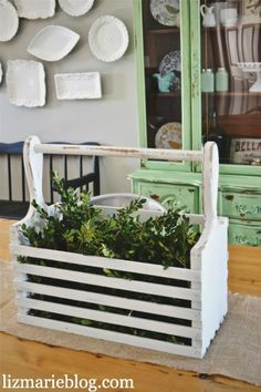 Thanks to a chippy coat of white paint, it's now the perfect spot to display greenery in a dining room. Now this cute planter reminds us of Joanna Gaines' shabby chic style on HGTV's Fixer Upper!  Learn more at Liz Marie Blog.