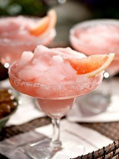 Frozen Pink Grapefruit Margaritas...  From: Barefoot Contessa's How Easy Is That-  1 cup ruby red grapefruit juice  1/2 cup fresh squeezed lime juice (about 4 limes)  1 cup triple sec orange liqueur  3 cups ice  1 cup silver tequila  1 lime cut in wedges, optional Kosher salt. #Pink #Yum