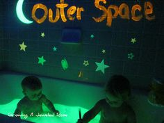 Outer Space Themed Bath- glowing water using a highlighter, glow in the dark paint, glow sticks, black light, space objects