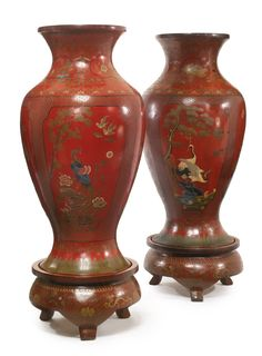A pair of large Chinese polychrome-decorated and incised wood vases on stands,late 19th century.