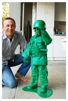 green plastic army soldier costume. love this.