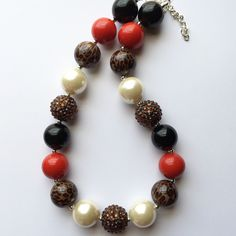 Leopard, red, black, and pearl chunky bubblegum necklace by Baublesandbowstoo on Etsy https://www.etsy.com/listing/251370355/leopard-red-black-and-pearl-chunky