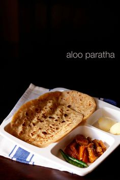 aloo paratha recipe with step by step photos - aloo paratha is one of the most popular paratha recipe from punjab. aloo paratha recipe is paratha stuffed with spiced aloo or potato mixture.