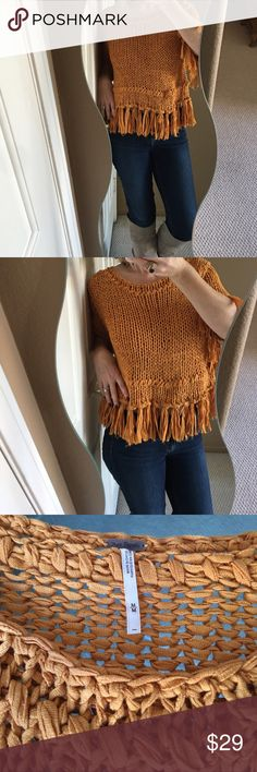 Free People Mustard Colored Crochet Woven Top Super unique and chic Free People woven crochet top! Mustard colored, 3/4 length sleeves, fringe detail on sleeves and hem, 100% cotton material. In excellent condition! Like new❤️ Free People Tops