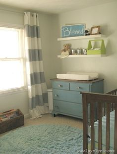 Aqua and gray boy nursery. Love the painted dresser, white shelves, large stripe curtains, and the little pop of green.