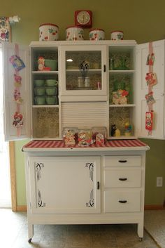 I want a hoosier cabinet like this one for my kitchen. So cute.
