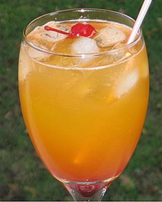 Gin, Peach Schnapps, Southern Comfort, Lemon Schnapps, Peach Nectar, lemon juice, splash grenadine & cherry for garnish. Whew!
