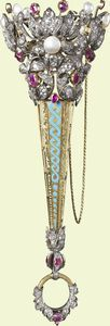 Bouquet holder    c.1855    French    Presented to Queen Victoria, This was a personal gift from the French Empress to Queen Victoria during the ten-day state visit to Paris in August 1855.    Gold, enamel, diamonds, pearls and rubies    18.2 × 6.9cm