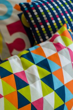 Cushions designed and made by Just So Interiors in Harlequin All About fabrics, 'Sum it Up' 'Kaleidoscope' and 'Abacus'