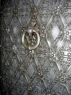 Castle door by ZoomLoes, via Flickr