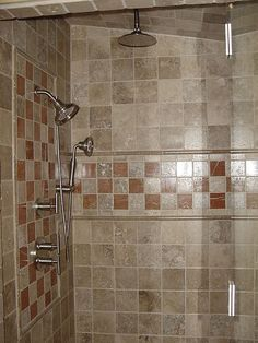 shower head and rain shower combo. Master Shower has Rain Head  Hand Held and shower head all controlled by a Awesome Great use of Limestone mosaic Rubbed Bronze