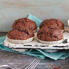 Kürbis-Kokos-Muffins: Muffins mit Kürbis? Auf jeden Fall: Lasst euch vom Geschmack der saftigen Kürbis-Muffins mit Kokos und Schokolade überzeugen.