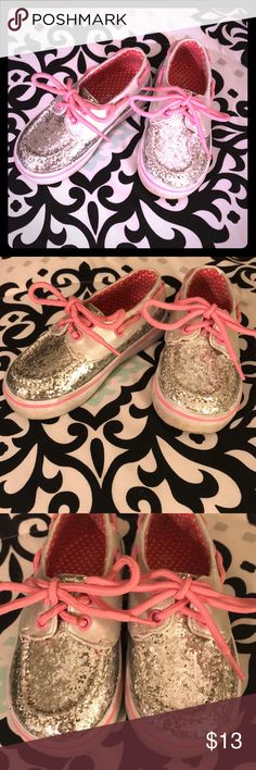 Toddler Silver & Pink Sparkle Tennis Shoes 💕 In Great Used Condition! FALLS CREEK KIDS Toddler Silver & Pink Sparkle Tennis Shoes!! Super adorable. Size 7. Pre-loved but still in great shape. The most wear is in the bottoms for sure. As pictured! Make a statement with these gems. 👑 Falls Creek Kids Shoes Sneakers