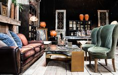 Dark decor inspired by the Paris flea. Elegant European style chairs in green mohair, leather sofa and custom coffee table. http://bdantiques.com/