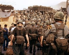 1960s 1965 ARRIVAL OF U.S. ARMY SOLDIERS IN VIETNAM 1ST CAVALRY DIVISION AIRMOBILE AS THEY LAND ON BEACH