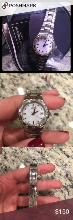Women's Citizen Echo-drive Watch Women's echo-drive with original paperwork and packaging. Very lightly worn, like new. Comes with extra links for customized sizing. Citizen Accessories Watches